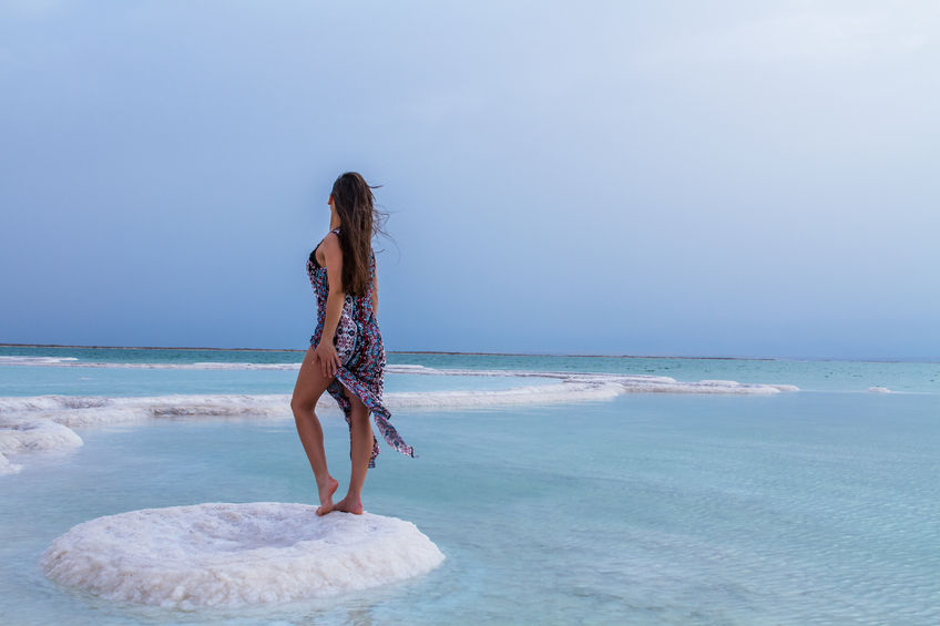 57484680 - young woman going to dead sea, israel